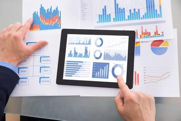 Businessman Analyzing Graph On Digital Tablet