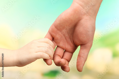 Child and father hands on bright background Poster