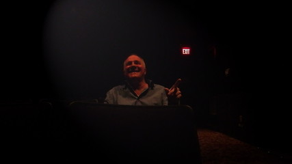 Man Laughing in Theater