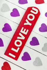 I love you words and hearts on white background