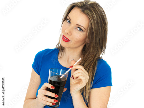 Leinwandbild Motiv Young Woman Drinking Fizzy Cola Drink
