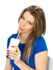 Young Woman Drinking a Glass of Sugar