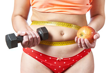 Woman with dumbbells and apple plans diet  and sport