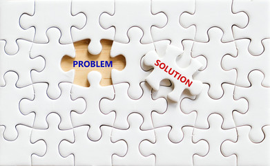 Solution and problem words on jigsaw puzzle, business concept