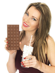 Young Woman Comparing a Chocolate Bar to a Glass of Sugar
