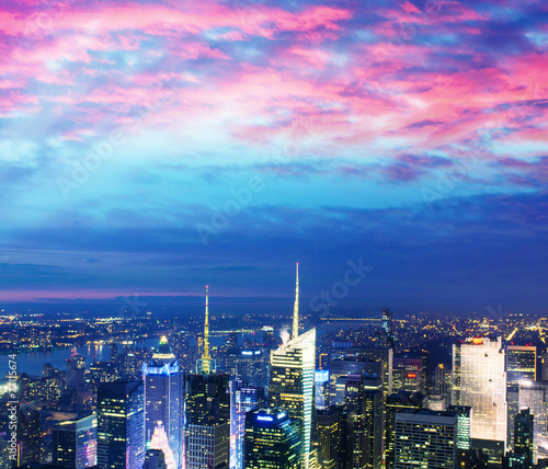 Stunning Manhattan skyline after sunset, NYC - 77115674