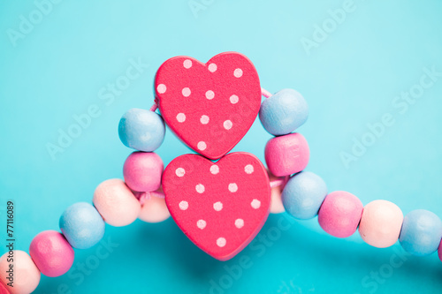 abstract toy heart shapes on blue background