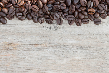 closeup coffee beans on wood background space for sample text