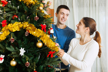 Adult couple decorating home