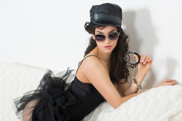 sexy woman with handcuffs in fashion glasses
