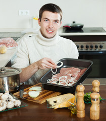 Smiling guy with raw meat