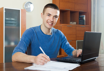 man  with laptop and financial documents