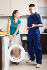 Housewife talking with worker