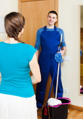 Housewife meeting smiling cleaner