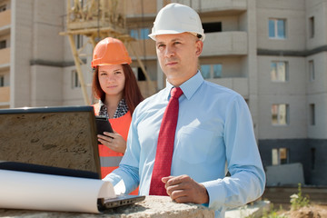 two workers works on the building site