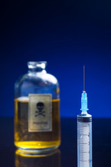 Vintage poison bottle and syringe