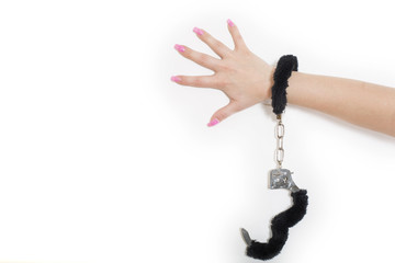 Beautiful female hand locked in the black handcuffs