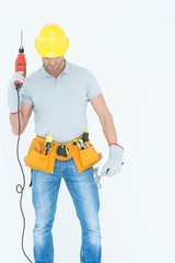 Technician holding drill machine over white background