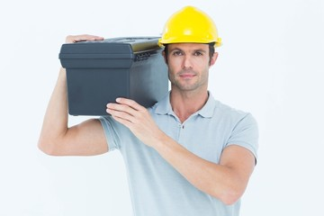 Confident worker carrying tool box on shoulder