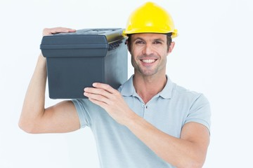 Happy worker carrying tool box on shoulder