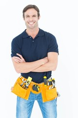 Confident man with tool belt around waist over white background