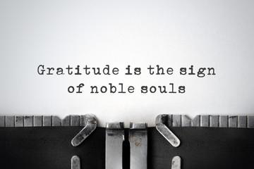 Gratitude. Inspirational quote typed on an old typewriter.
