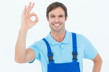 Smiling carpenter showing OK sign
