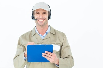 Delivery man in headphones holding clipboard