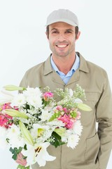 Happy delivery man holding bouquet