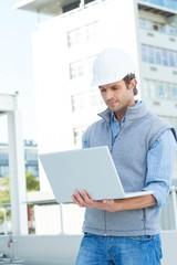 Confident architect using laptop