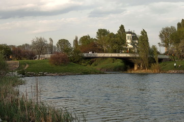 Small dam and christian church in the  residential district