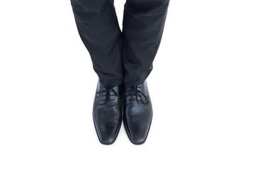 Businessmans feet in black brogues