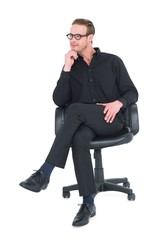 Thoughtful businessman sitting on a swivel chair