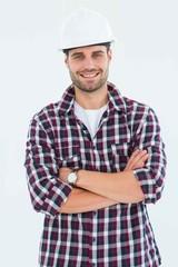 Handome male handyman standing arms crossed
