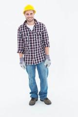 Happy male repairman wearing hard hat