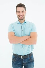 Confident young man standing arms crossed