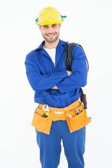 Confident repairman standing arms crossed