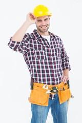 Confident handyman wearing hard hat