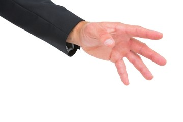 Businessman holding hand out
