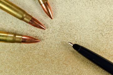 Pen and three bullets
