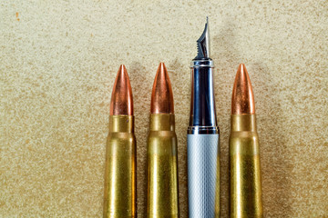 Pen and bullets