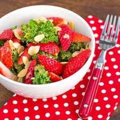 Healthy kale salad with strawberries and almond