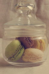 glass cup full of macaroons
