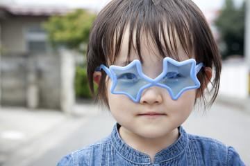 a girl wearing star-shaped sunglasses