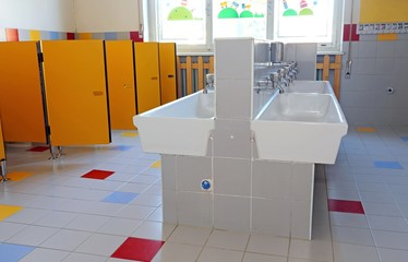bathroom of the nursery school with ceramic sinks