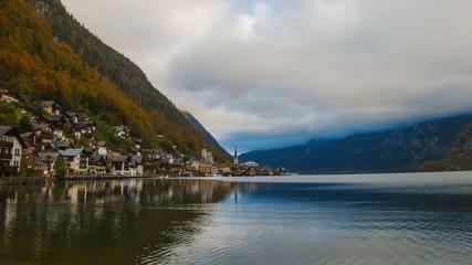 Sunset over city and lake Hallstatt in Austrian Alps