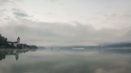 Clouds and fog moving over the lake