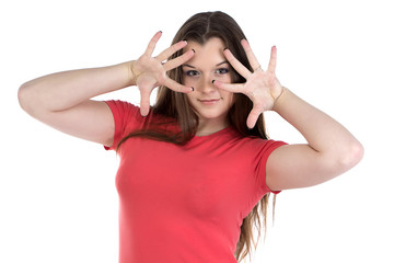 Photo of teenage girl with hands near face