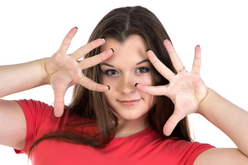 Image of teenage girl with hands near face