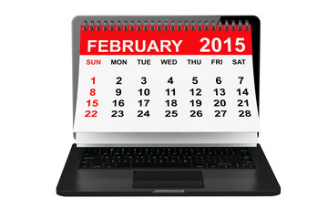 February calendar over laptop screen